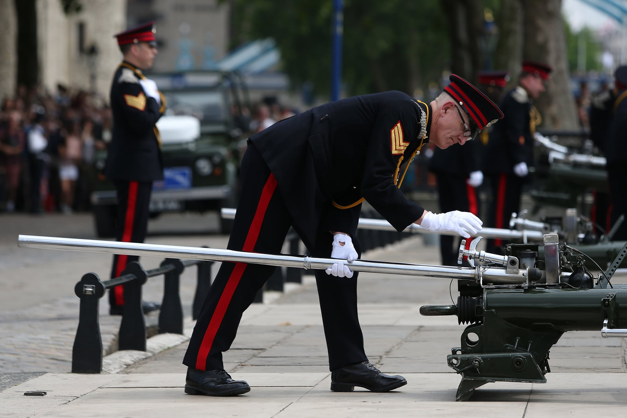 Outside the Tower of London, the Honourable Artillery Company prepared for a 62-round gun salute.