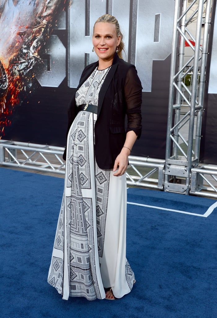 A pregnant Molly Sims attended the premiere of Battleship in LA.