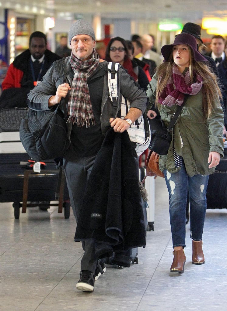 Tim McGraw had his hands full after landing in London with his family.