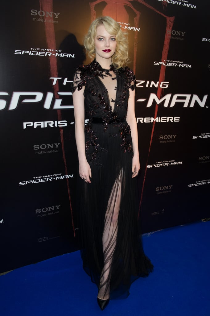 Emma stunned in this A/W '12 Gucci number at the Paris premiere, complementing the siren look with 1920s-inspired waves and a deep crimson lip.