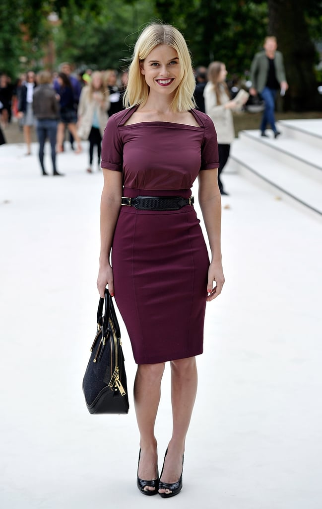 Alice Eve looked ultra-chic in a fitted burgundy sheath at Burberry.