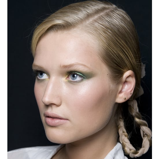Want something easy but unique for a wedding you've been invited to? Try simply braiding a length of chiffon or tulle into a low braid on the back of your head, then looping it into a knot, as stylists did at Jason Wu. It's stylish and unexpected, but not hard to create. Source: Greg Kessler