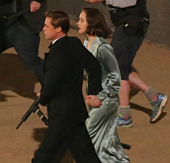 Brad Pitt and Marion Cotillard hold hands for a scene on set of Allied
