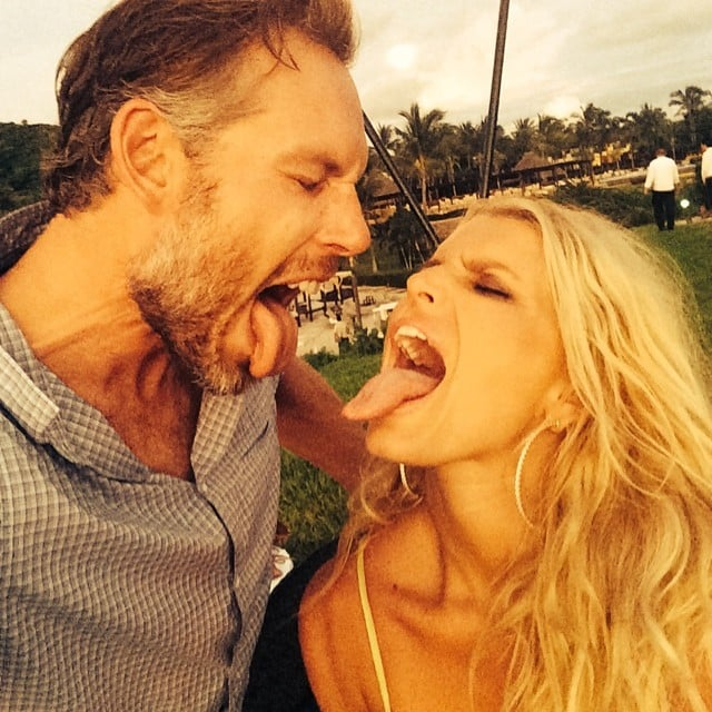 Jessica and Eric stuck their tongues out at each other in this photo from their honeymoon in July 2014.