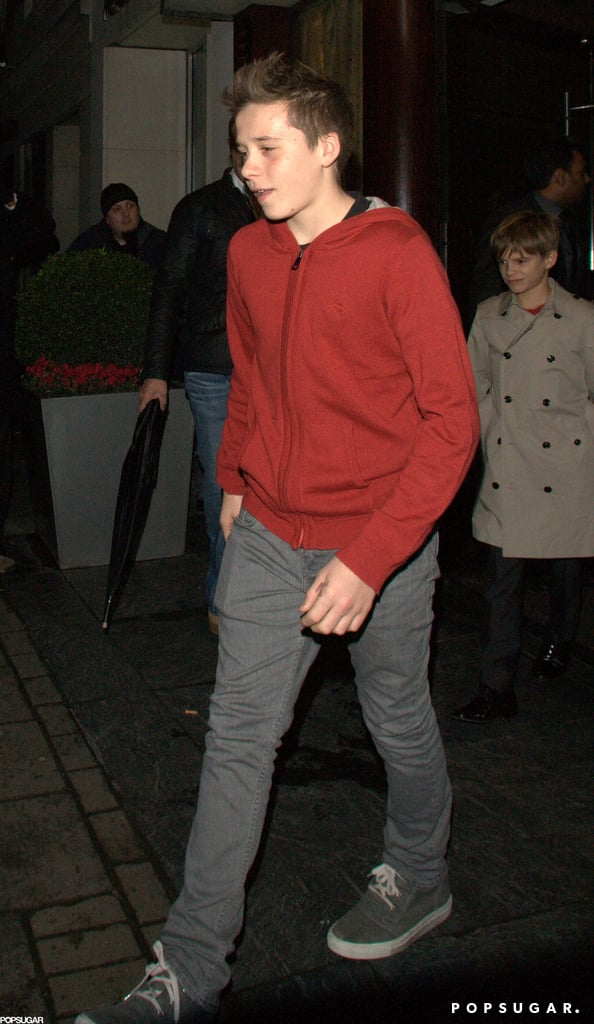 Brooklyn Beckham led the way for younger brother Romeo Beckham as they left dinner with dad David Beckham and a friend Friday.