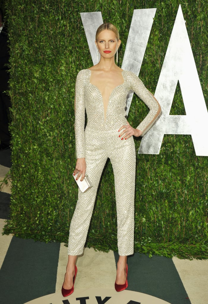 Karoline Kurkova also opted for a jumpsuit at Vanity Fair's Oscar party, choosing a glamorous iteration with a flash of sparkle.