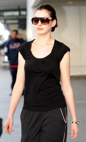 Anne Hathaway at LAX in Black Plastic Sunglasses