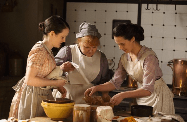 """Working women didn't catch a break from corsetry, either. Daisy, Mrs. Patmore, and the rest of the """"downstairs"""" group would have worn corsets as they cooked, cleaned, and served in the home. Source: ITV"""