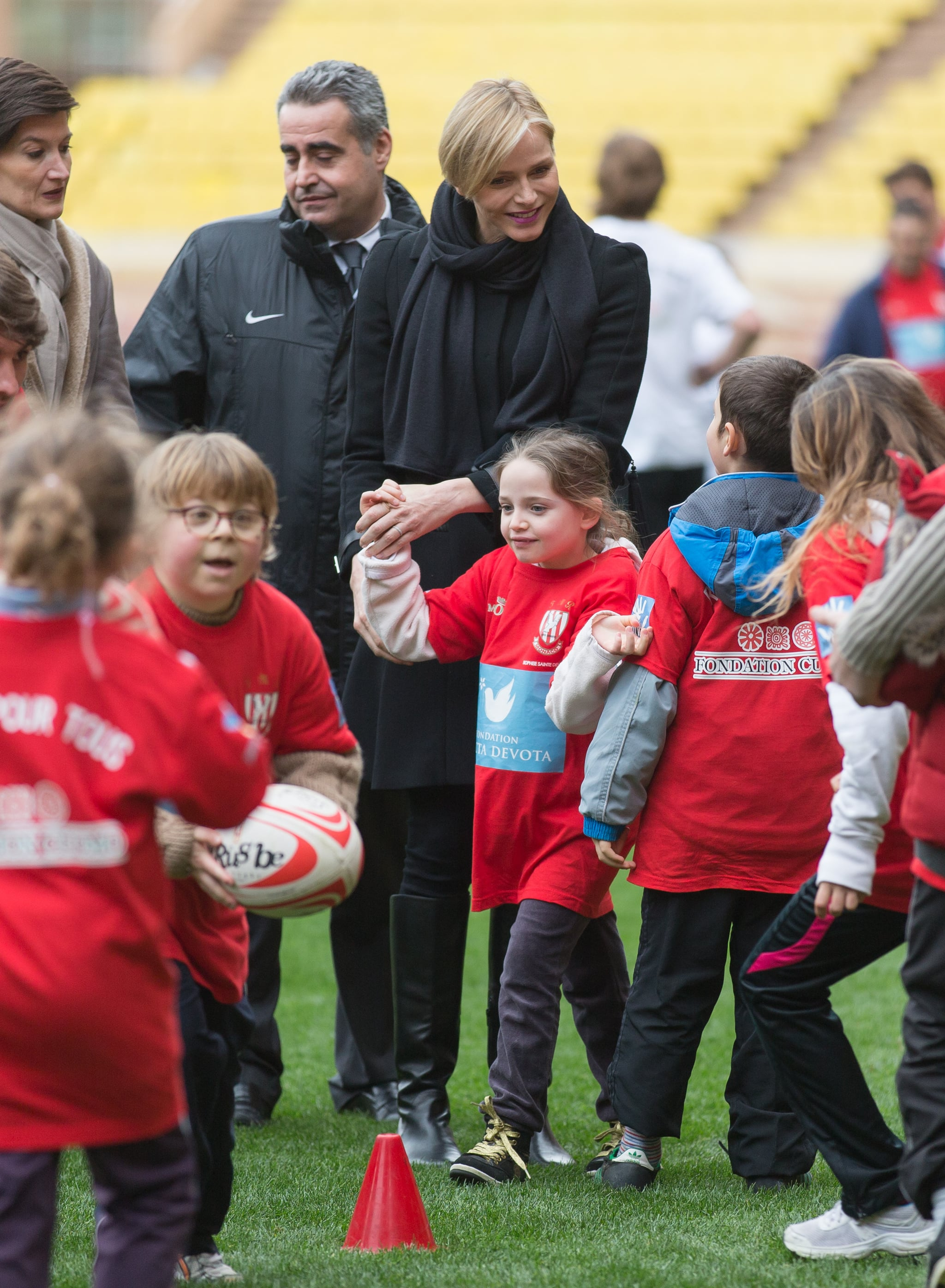 Princess Charlene channeled her sporty side while hanging out with children at the 4th Challenge Sainte-Devote of Rugby in February 2014.