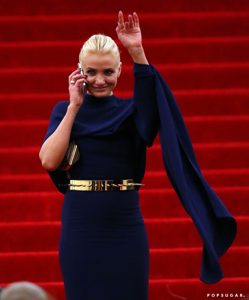 Cameron Diaz talked on her cell phone and waved at fans as she exited the bash.