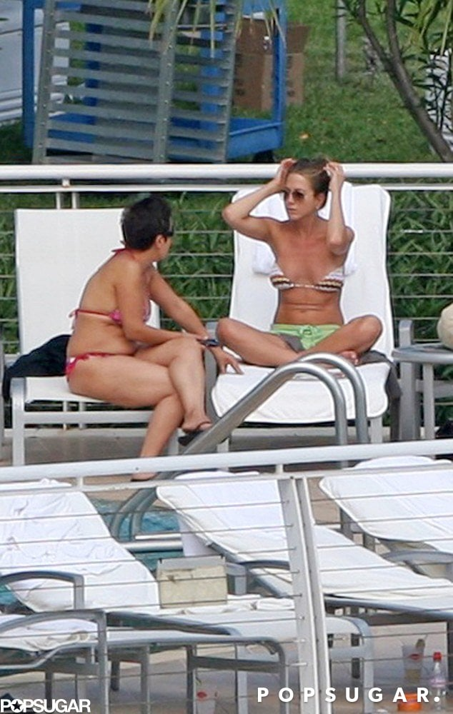 Jennifer chatted with a friend on a lounge chair in Miami in May of 2008.