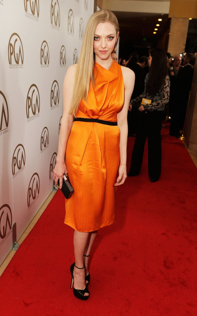 Amanda Seyfried added a jolt of colour to the red carpet in an orange silk Roland Mouret dress, Jimmy Choo shoes, Cathy Waterman earrings, and a Judith Leiber clutch.
