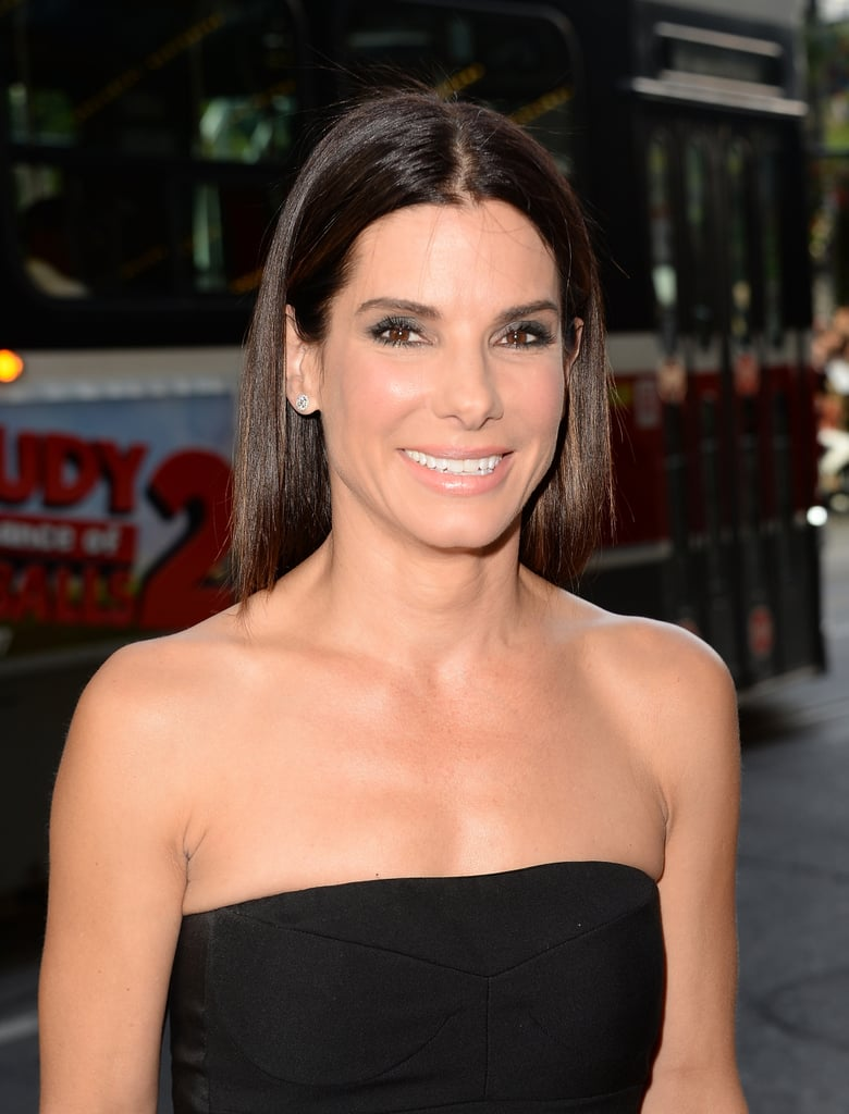 Sandra Bullock looked gorgeous with her signature glossy hair and a gunmetal smoky eye at the Gravity premiere.