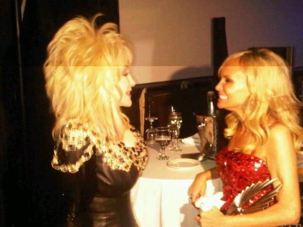 """Kristin Chenoweth with her """"idol"""" Dolly Parton. Both looking sparkly."""