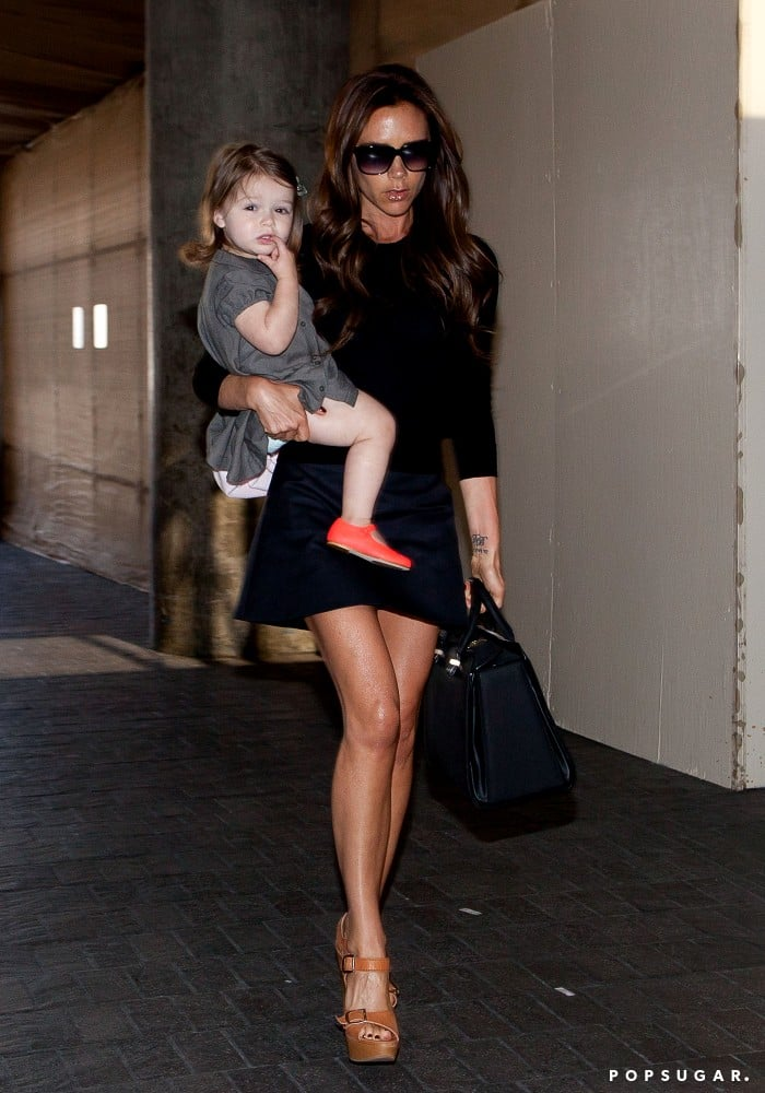 Victoria Beckham Legs It Through LAX With All Four Kids