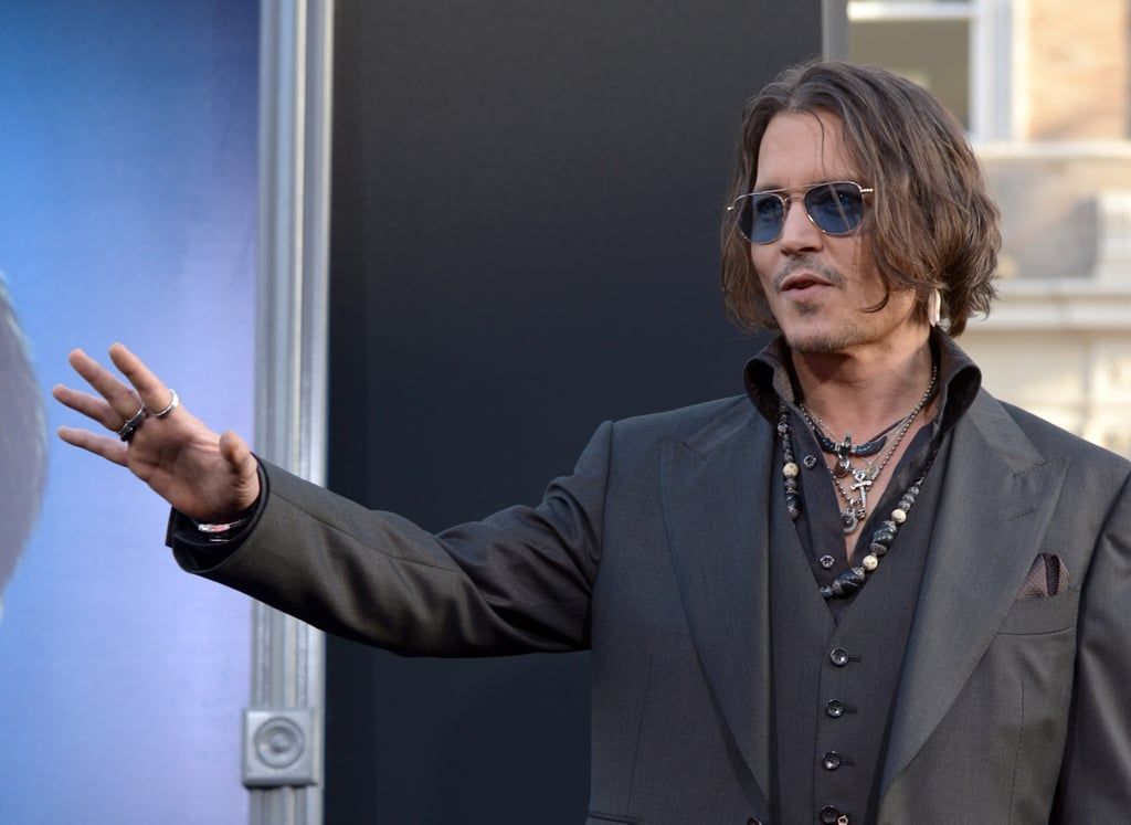 Johnny Depp gave a wave at the Dark Shadows premiere in LA.
