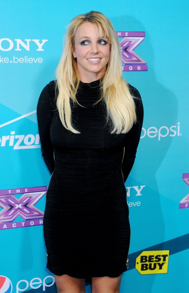 Britney Spears posed for photos at The X Factor finalists party.