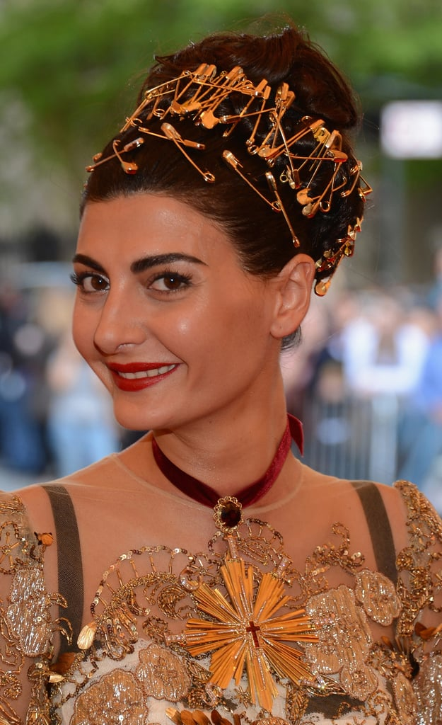Giovanna Battaglia wore an eye-catching gold safety pin headpiece.
