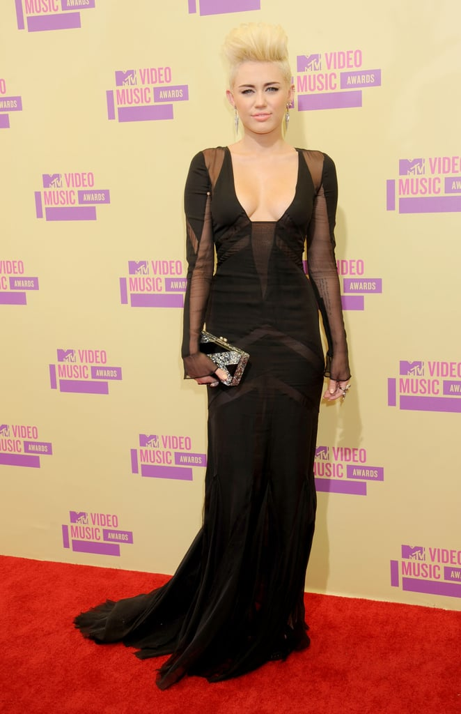 Miley rocked a low-cut Emilio Pucci gown with sheer panels for the MTV VMAs in September 2012, which worked perfectly with her new short blond 'do and silver spike earrings.