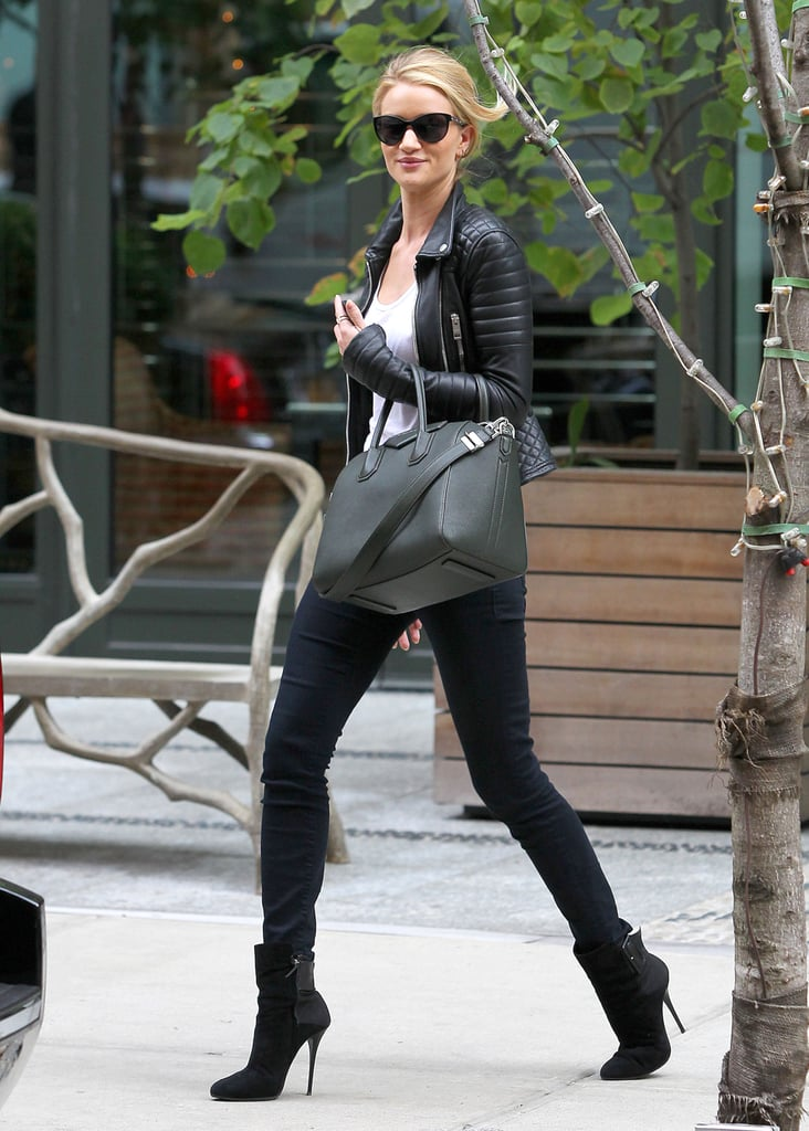 Rosie Huntington-Whiteley was every bit the cool chick in a black leather biker jacket, sky-high booties, and a structured Givenchy bag in NYC.
