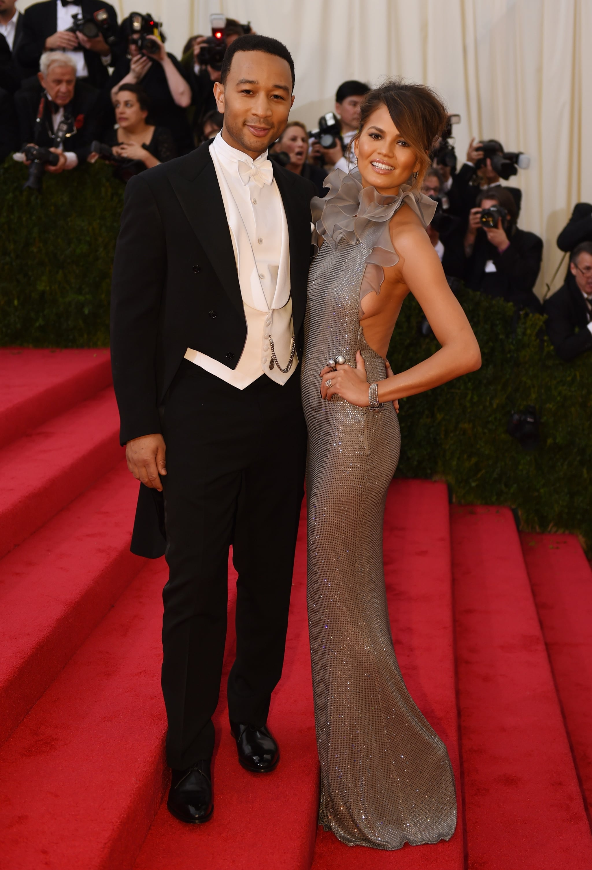John Legend and Chrissy Teigen took a break midway up the grand staircase.