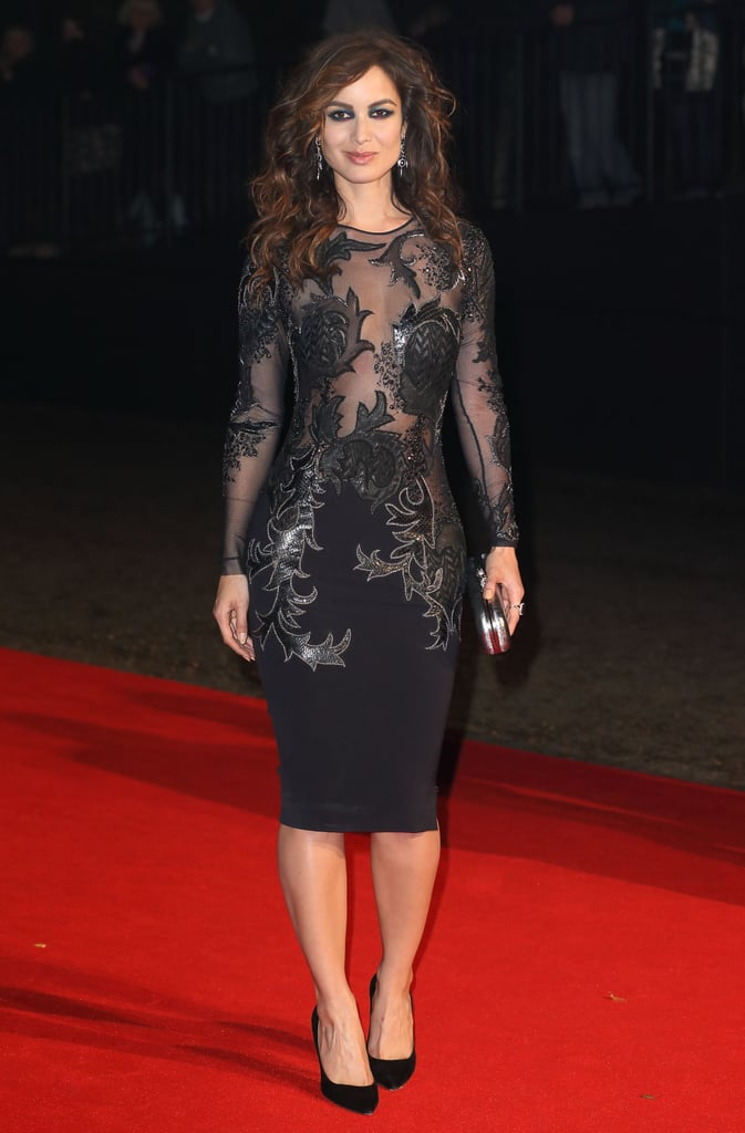 At the Skyfall London premiere afterparty, Bérénice Marlohe wore a sheer Julien Macdonald dress paired with black Sergio Rossi pumps.