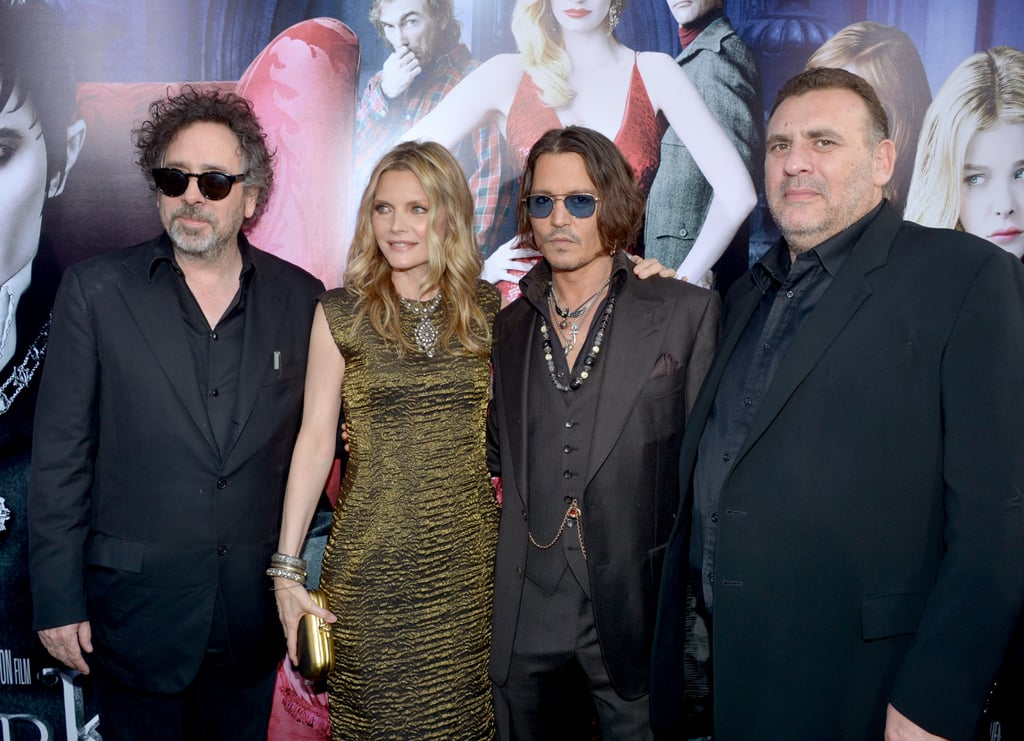 Director Tim Burton and producer Graham King surrounded costars Michelle Pfeiffer and Johnny Depp at the Dark Shadows premiere in LA.