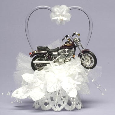 Maybe the lace represents one of you, and the motorcycle the other,  but I think this motorcycle wedding cake topper ($46.95) is downright tacky. It's not so much that it's a motorcycle, it's that it's a motorcycle in a field of lace. If you're both into motorcycles, get a groom's cake shaped in a motorcycle, or just go for a motorcycle-couple topper and quit trying to combine elegance and motorcycle at the same time.