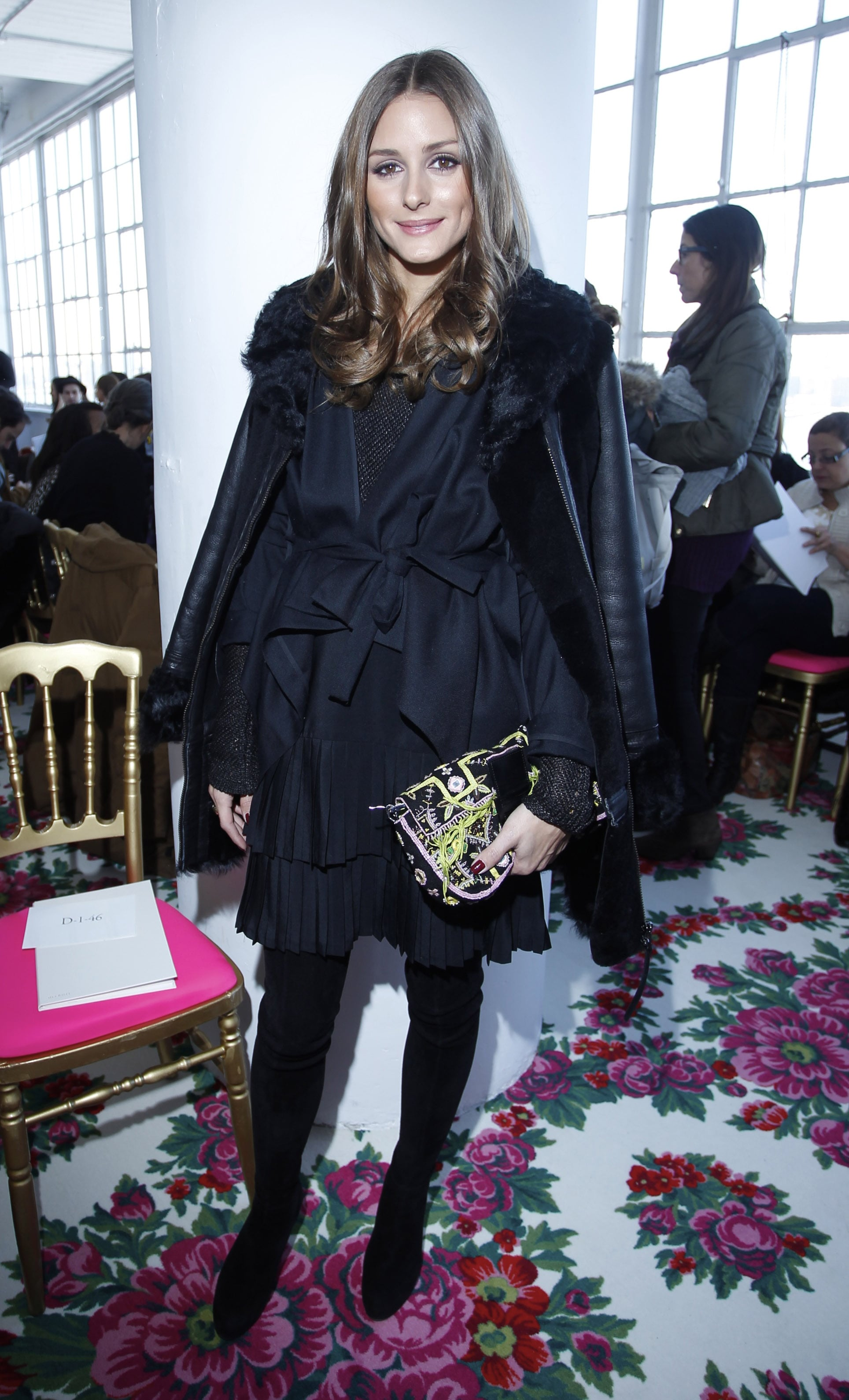 Olivia paired her navy-and-black layered look with a neon Fendi clutch at Delpozo at NYFW.