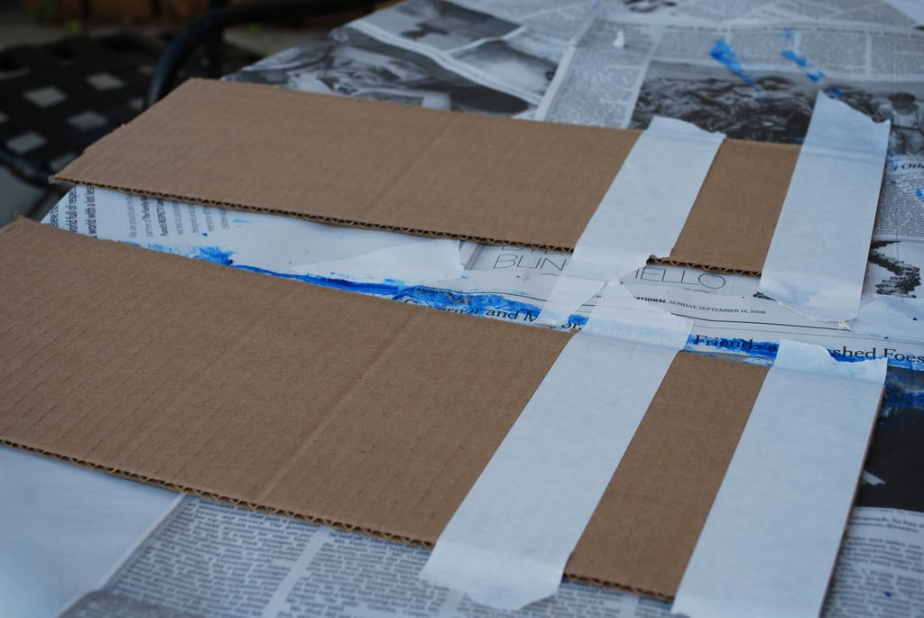 Next, create the wings for your plane.  Place strips of tape on the two longer flaps that were cut off of the plane in the first