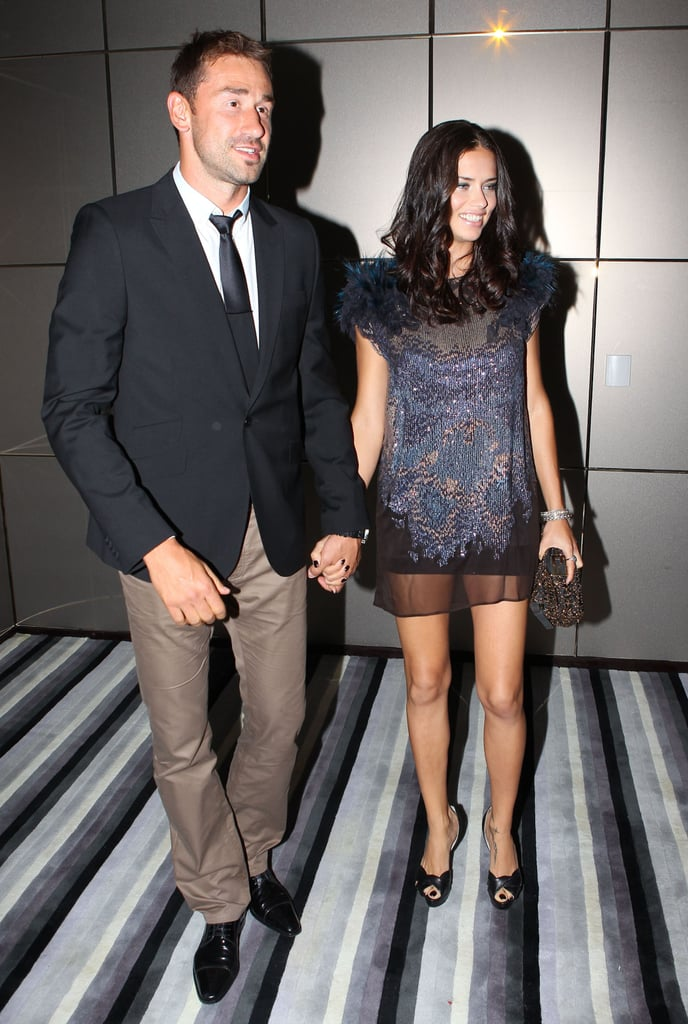 Adriana Lima and Marko Jaric held hands at an event.