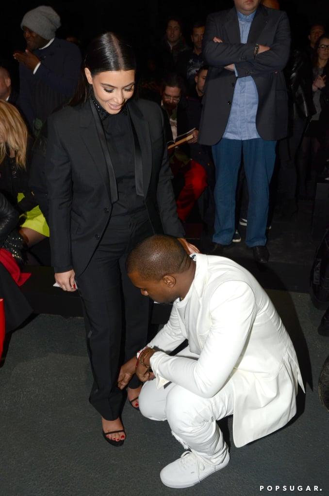 Kanye West helped Kim Kardashian with her shoe.
