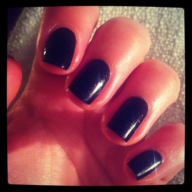 Alison's a big fan of CK One Color Nail Polish — she loves the super wide brush and how it goes on so smooth. This particulard shade is called Coal.