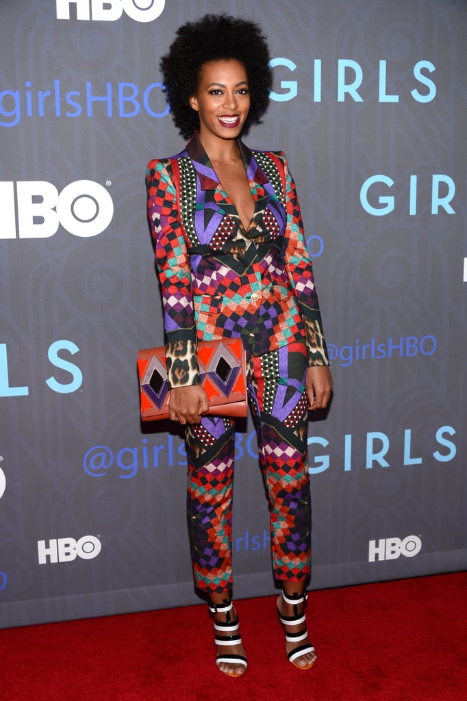 In signature Solange fashion, the brunette singer wowed in a geometric-print Just Cavalli suit, black-and-white Bottega Veneta sandals, and a coordinating colourful clutch at the season two premiere of Girls in NYC.