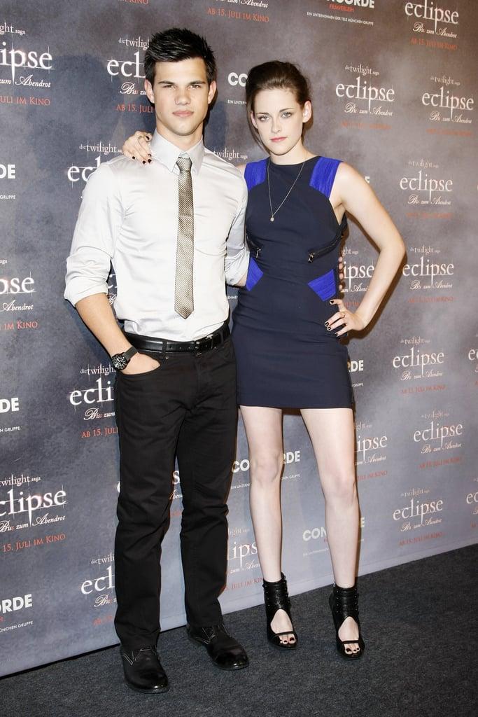 Kristen rocked a hot Versace number and hung onto Taylor Lautner to promote Eclipse in Berlin in June 2010.