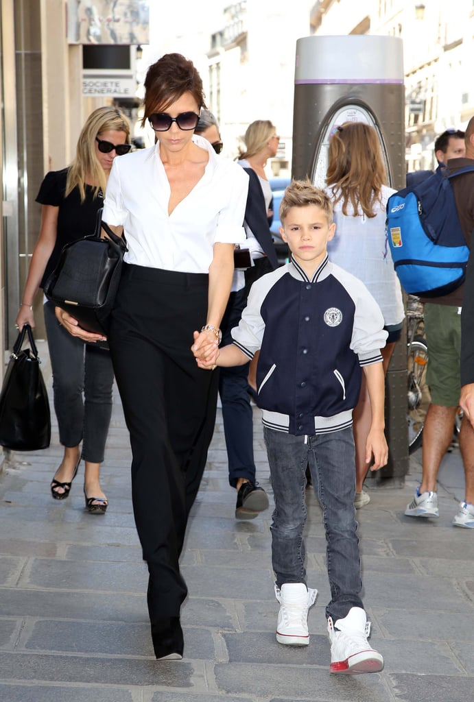Victoria Beckham held Romeo's hand as they walked around France in July.