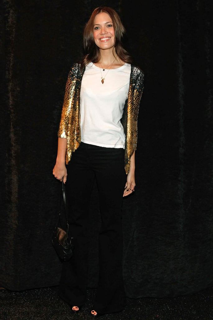 Mandy Moore adds just a hint of sparkle via a silver and gold jacket.