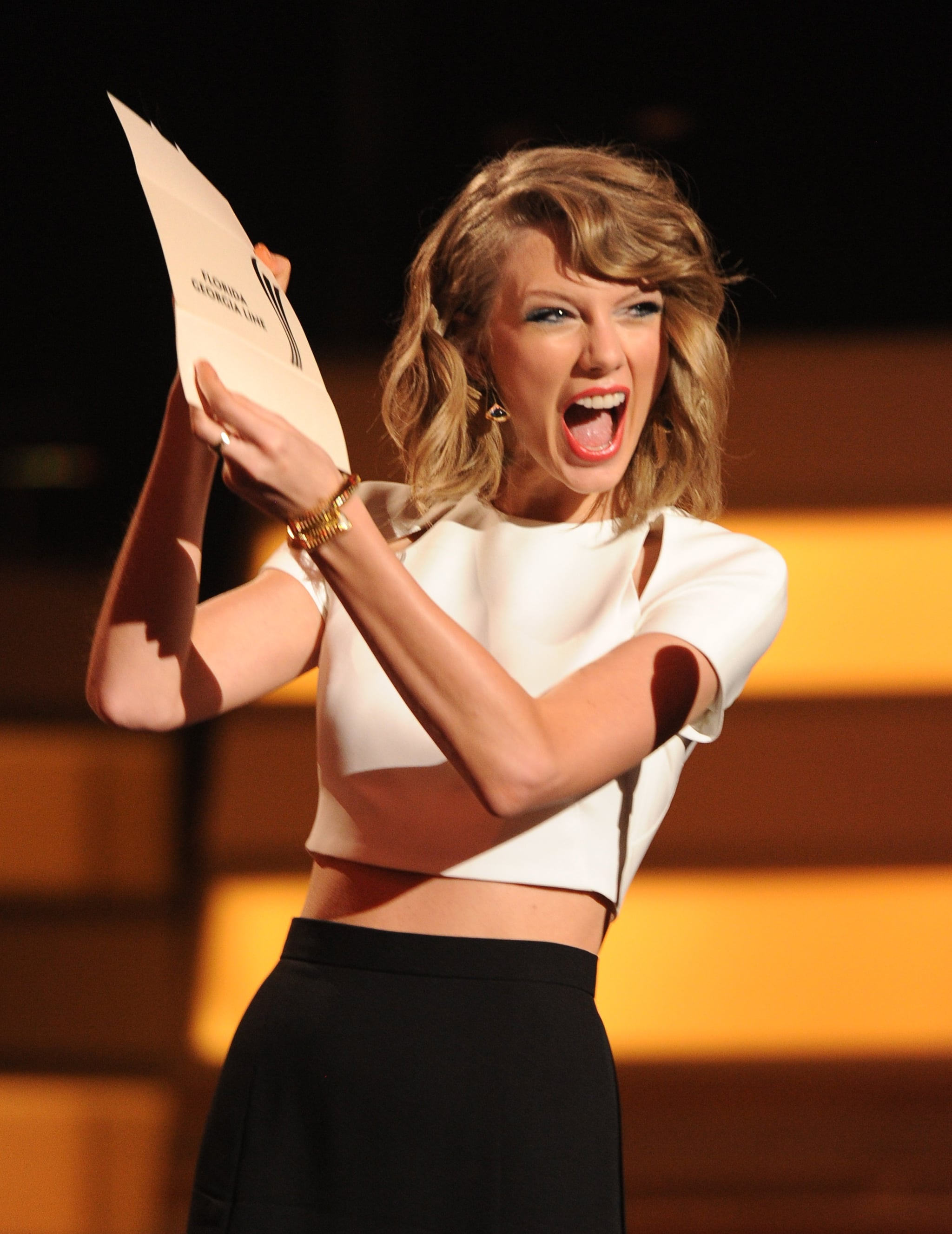 Taylor Swift brought her enthusiasm — and bare midriff! — to the Academy of Country Music Awards in Las Vegas.
