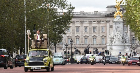 See Mr. Bean Drive With A Mop While Reclining Atop His Car In 2015
