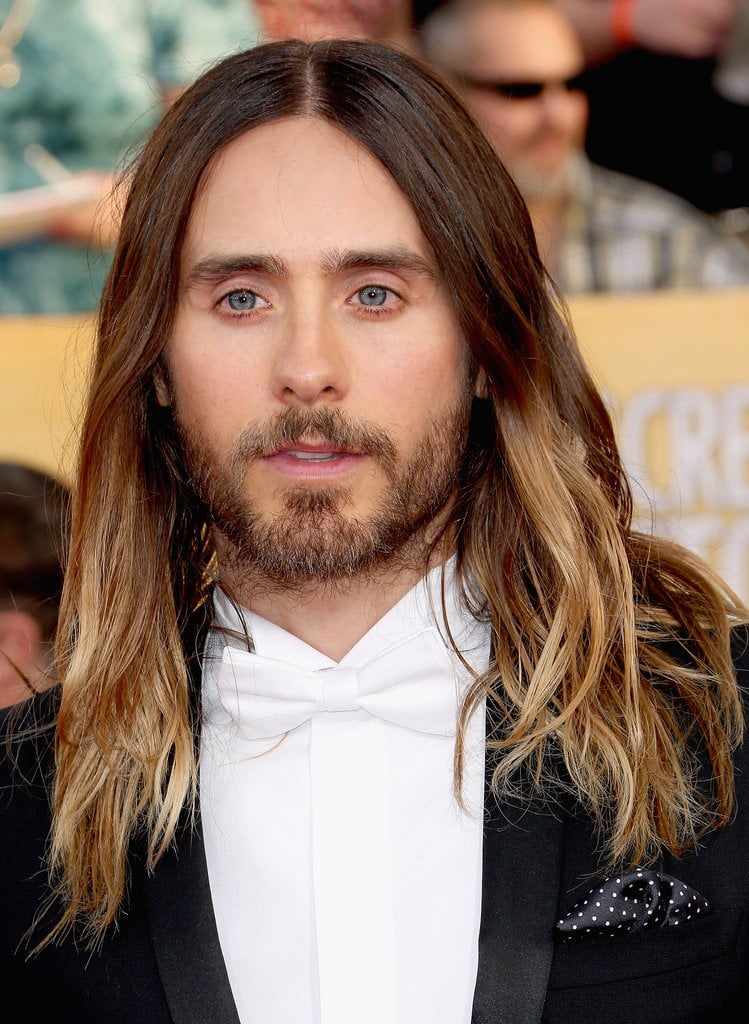 POPSUGAR: Before the Oscars, we polled our readers to see how Jared should wear his hair. The options were beach waves, ponytail bun, or the wet look. The results: 45 percent picked waves, 42 percent picked an updo, and 13 percent said the wet look. Our readers had it right! So how did you and Jared reach this monumental decision? Chase Kusero: We've definitely been experimental, and that's been a key to his hair looking great. He likes to have his style unique to the moment. We did ponytail bun for Golden Globes, and if we did it again, it would seem [old]. We did the Indie Spirit Awards the night before, so he started with product in his hair, and then he slept on it. When he put his jacket on, we knew it had to be down for an iconic vibe. We knew that was it.  PS: What are some tips you can offer our readers to get Jared's undone beach waves at home? CK: We did subtle things, and it just worked. Yesterday was a big day for him, so his hair was kind of an afterthought. Washing the hair less is the key. Using some sort of wave-enhancing shampoo will add more moisture. That has been the key: moisturizing the hair allows it to hang well, have shine, and separate. The more moist the hair is, the more it can wave. Use a flat iron to bend 10 pieces, and it will give it that separation and make it feel undone. But we never use a curling iron or anything on Jared, or it will look too much like glam waves. Straight ends are also the key. Don't go all the way down with the hair iron to keep ends straight. It will make it look more disheveled. PS: You have said that he doesn't and will never wear extensions. What are some natural tips for growing hair long? Does he get routine trims or eat certain foods? We heard he is a vegan. CK: In the case of a female client, trimming is more of a necessity. When we started the process of growing out his hair, he left it in my hands. So we wanted it to get to a certain point so it doesn't look cut. Trimming it to make it grow is a myth. 