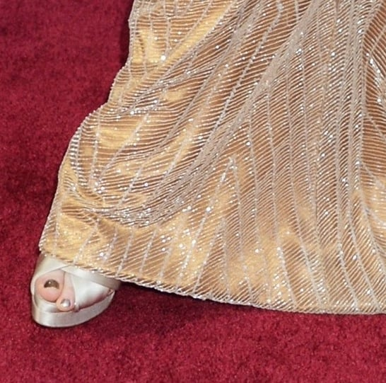Jessica Chastain's gold Armani Privé creation made a red-carpet match with Christian Louboutin pearl satin peep-toes.