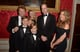 Prince William posed for photographs with Jon Bon Jovi and his family at a gala at Kensington Palace in November 2013.