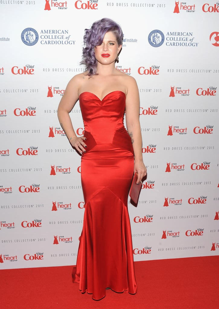 Kelly Osbourne showed off her curves in a strapless red satin mermaid gown at The Heart Truth's Red Dress collection.