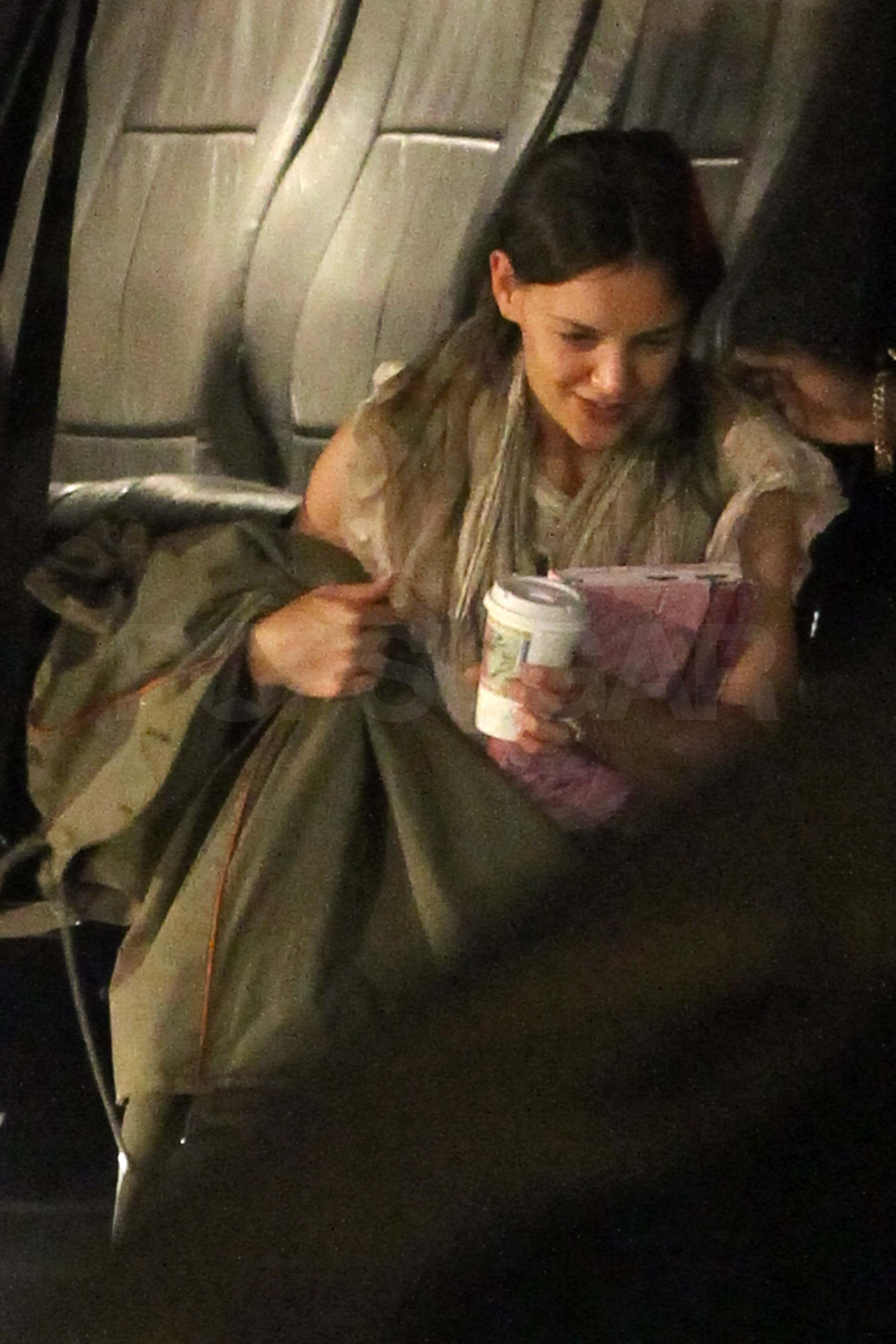 Katie Holmes landed in NYC by helicopter.