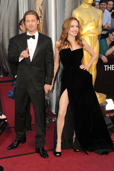 Brad Pitt in a tuxedo and Angelina Jolie in a black gown at the Oscars.