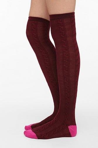 Urban Outfitters' cozy two-toned cable knit over-the-knee socks ($14) are ideal for layering over a pair of tights (and with riding boots) for an extra warm cold weather look.
