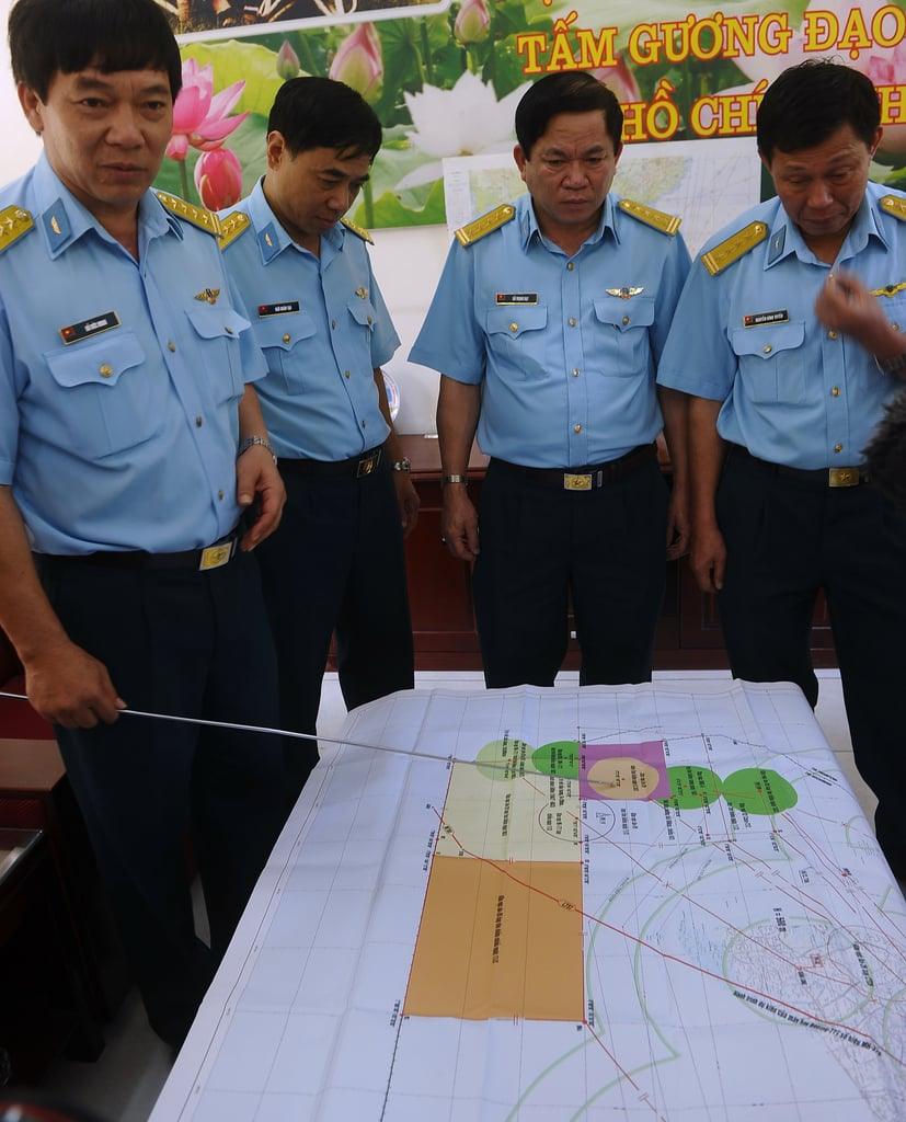 The chief of staff of Vietnam Air Force's 370 Division pointed at a map while discussing the search efforts at Tan Son Nhat International Airport in Ho Chi Minh City, Vietnam, on Saturday.