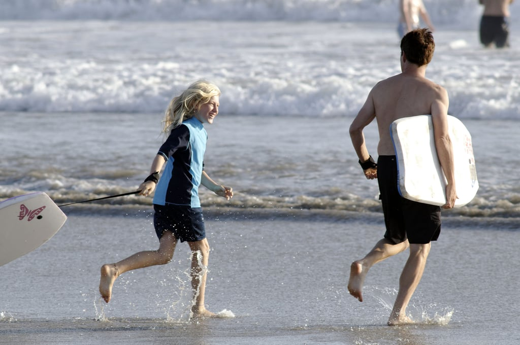 Stephen Moyer and Lilac Moyer ran on the beach.
