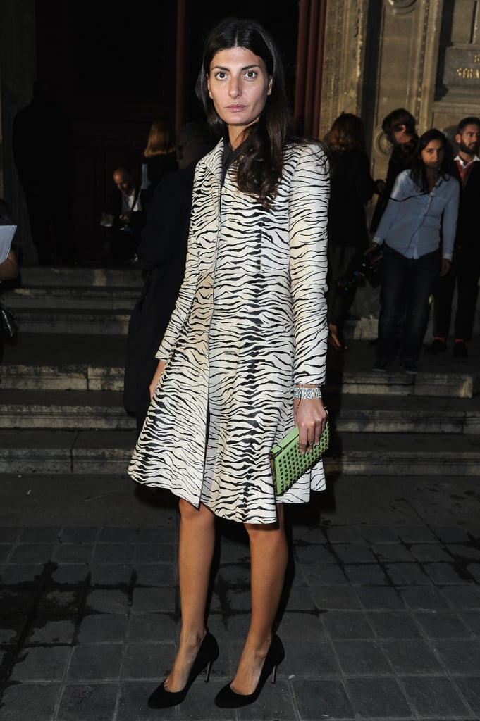 Giovanna Battaglia outfitted an animal-print coat with added interest from her lime green studded clutch.