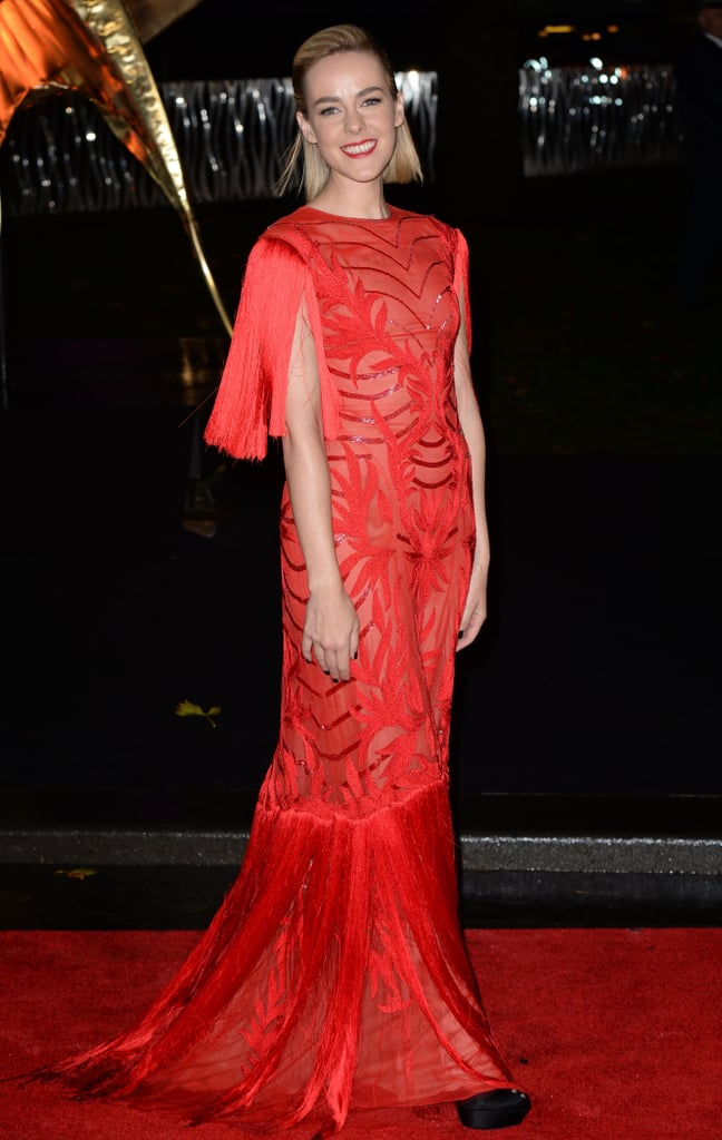 Jena Malone stunned in a bright red Monique Lhuillier gown and matching red lip at the world premiere.